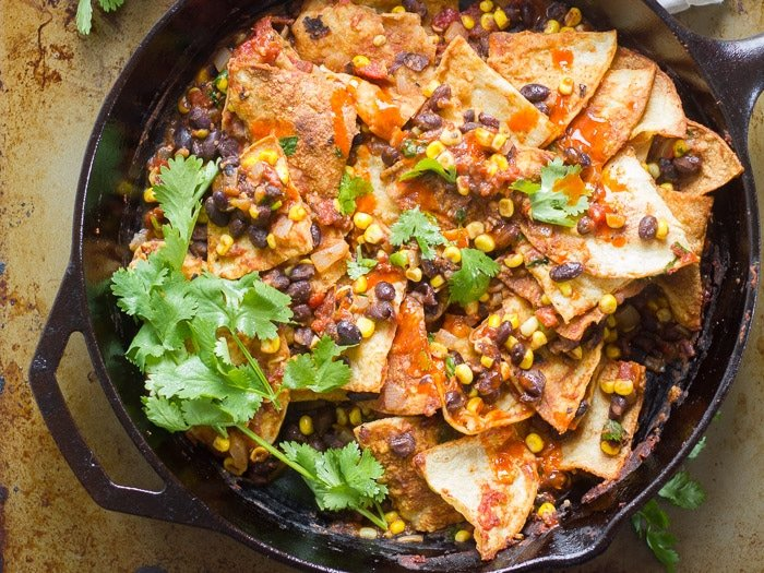 Black Bean Chilaquiles in a Skillet with Sprigs of Cilantro