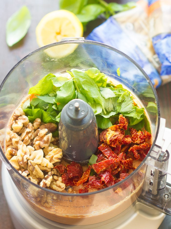 Sun-Dried Tomato Pesto Ingredients in a Food Processor Bowl