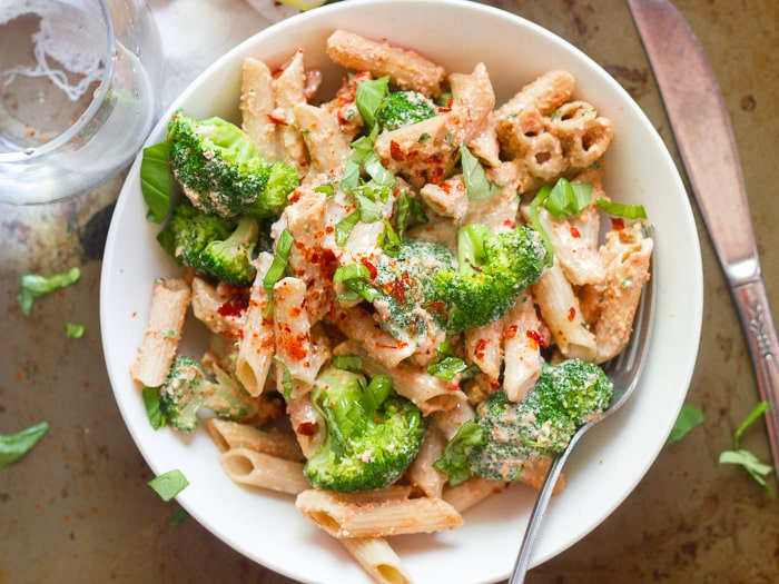 Overhead View of a Bowl of Creamy Vegan Sun-Dried Tomato Pasta with Broccoli