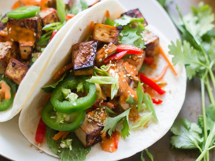 Close Up of Two Smoky Tofu Banh Mi Tacos on a Plate