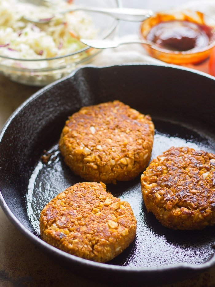 Three Barbecue Chickpea Burger Patties in a Skillet
