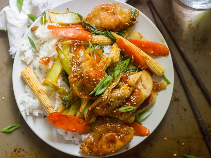 Overhead View of a Plate of Veggie & Dumpling Stir-Fry Over Rice