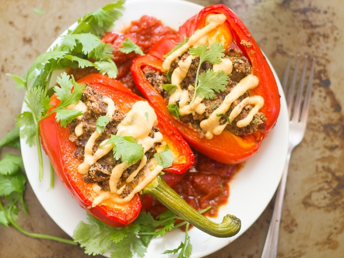 Plate Topped with Black Bean Burger Stuffed Pepper Halves and Fresh Cilantro