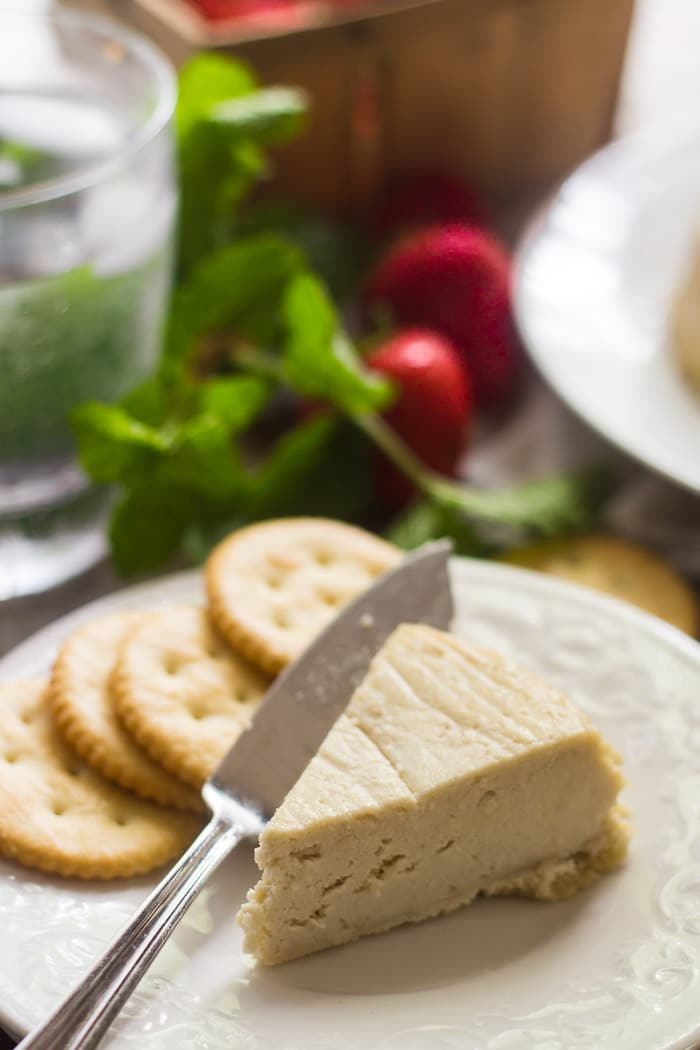 Wedge of Cashew Camembert on a Plate with Crackers