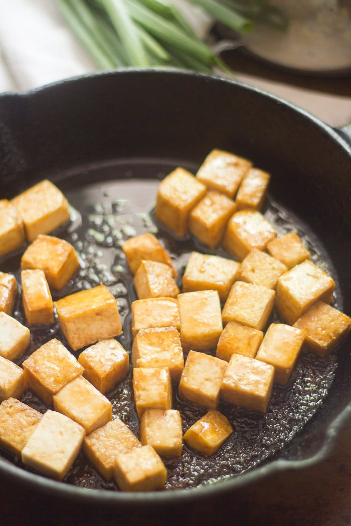 Tofu Cubes Sizzling in a Skillet