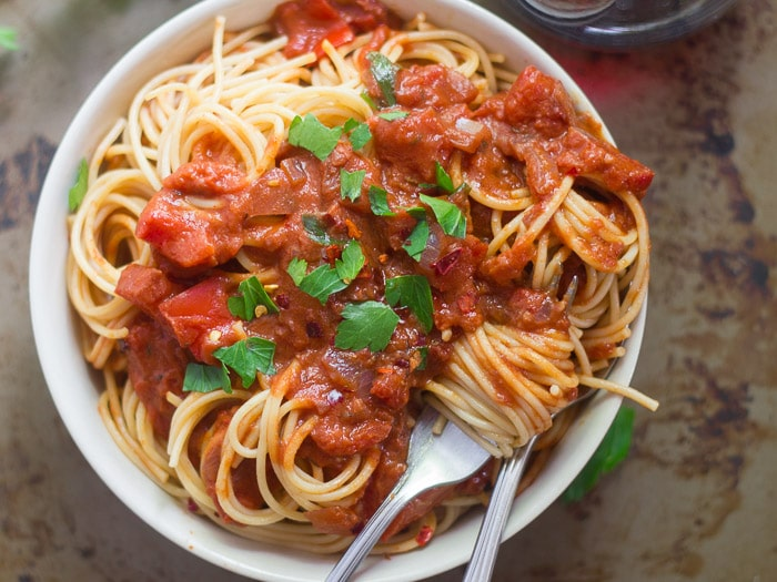 Overhead View of a Bowl of Spaghetti & Tomato Cream Sauce