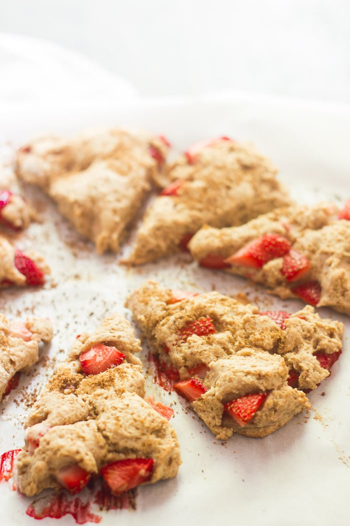 Vegan Strawberries & Cream Scones arranged on a Parchment Paper-Lined Baking Sheet