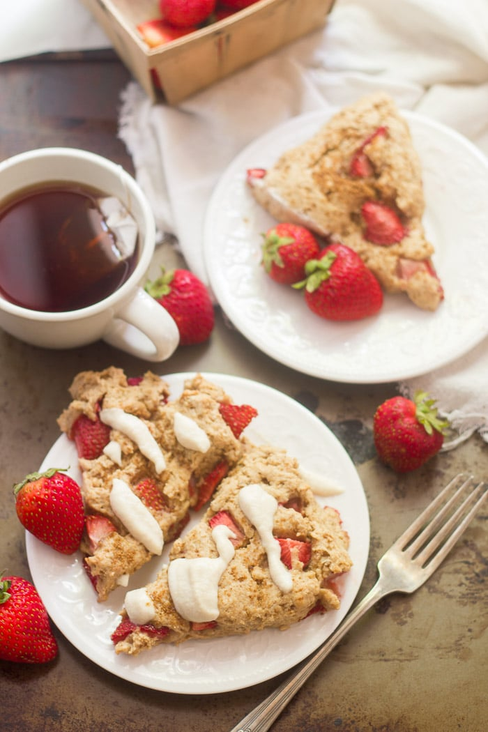 Vegan Strawberries & Cream Scones on Plates with Fork, Napkin and Tea Cup
