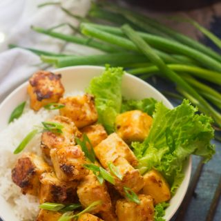 Bowl of Bang Bang Tofu, Rice and Lettuce with Scallions in the Background