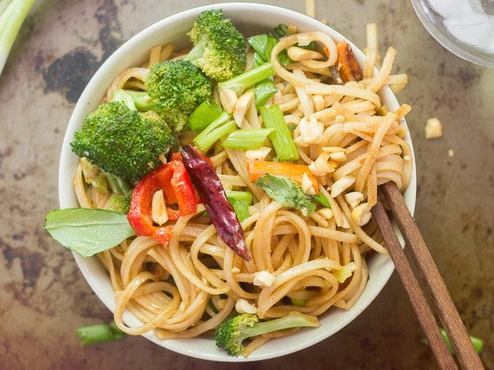 Overhead View of a Bowl of Stir-Fried Hoisin Noodles with Chopsticks