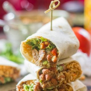 Three 7 Layer Burrito Halves Stacked and Held Together with a Skewer