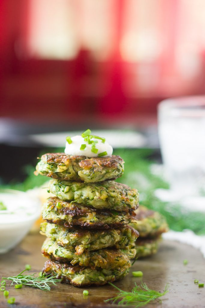 Stack of Vegan Zucchini Fritters Topped with Cashew Cream and Fresh Chives