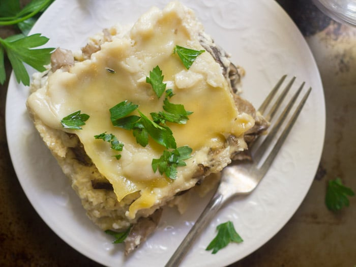 Overhead View of Creamy Vegan Mushroom Lasagna on a Plate with Fork