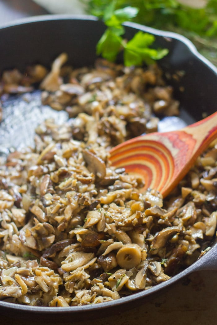 Mushrooms in a Skillet with Wooden Spoon