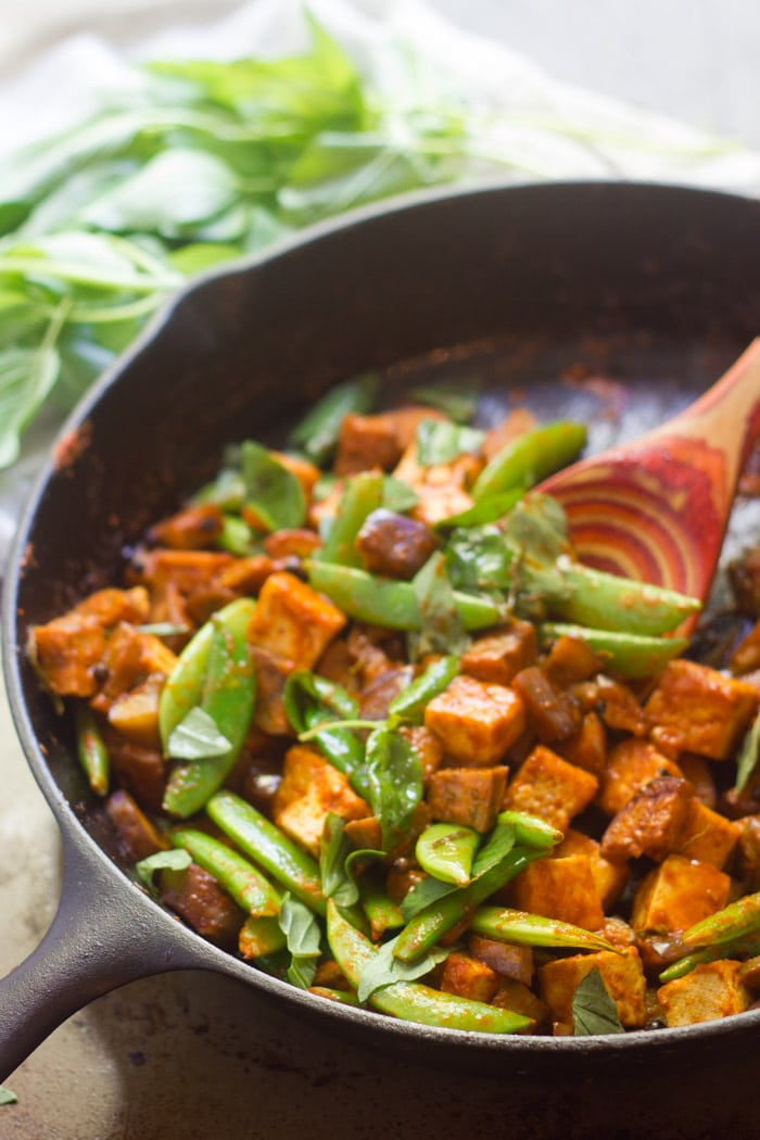 Tofu & Eggplant Red Curry Stir-Fry in a Skillet with Spoon