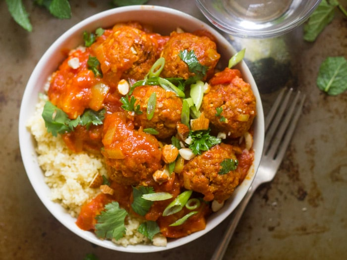 Overhead View of a Bowl of Vegan Moroccan Meatball Stew with Fork