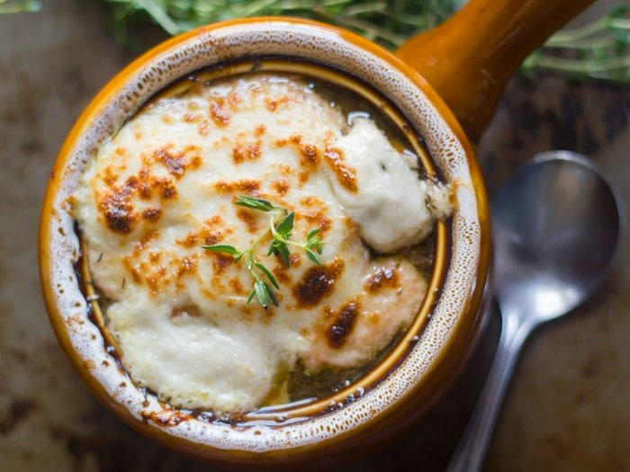 Crock of Vegan French Onion Soup Topped with Vegan Mozzarella