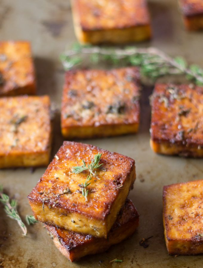 Savory Lemon & Herb Baked Tofu Pieces on a Baking Sheet with Fresh Thyme