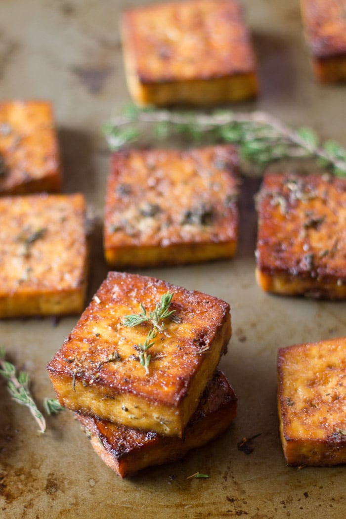 Baked Tofu Squares and Fresh Herbs on a Baking Sheet