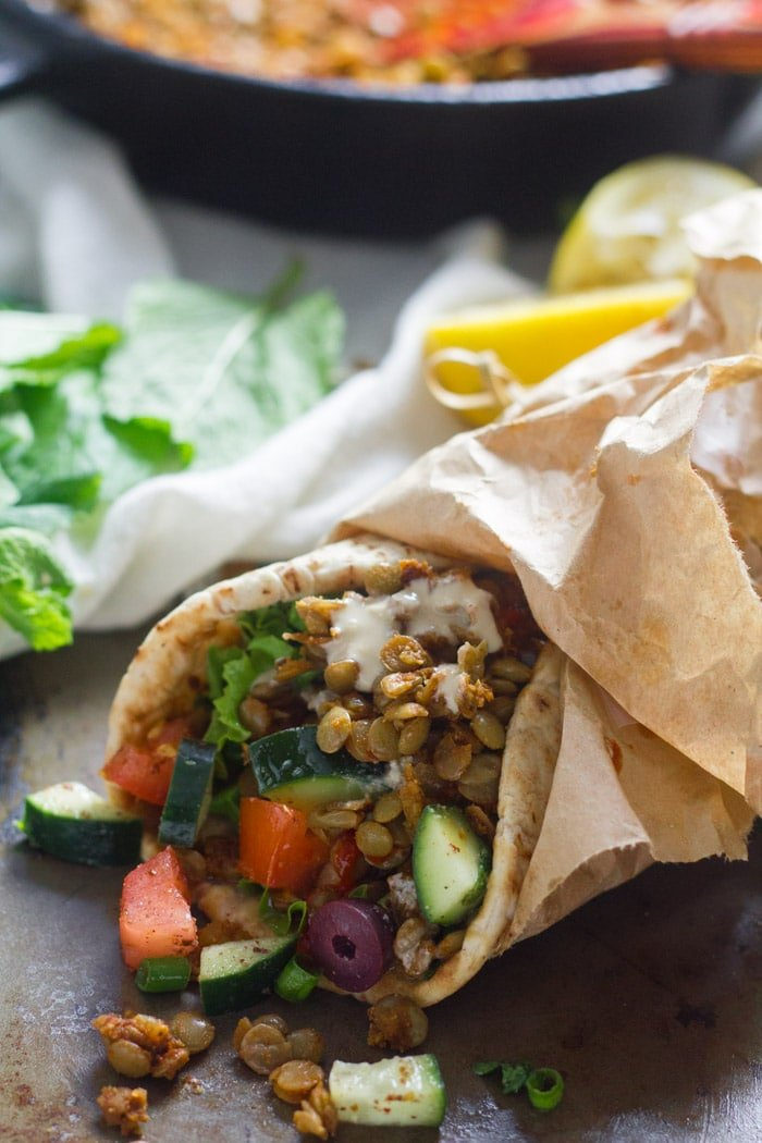 Lentil Shawarma Pita with Skillet and Lemon Halves in the Background
