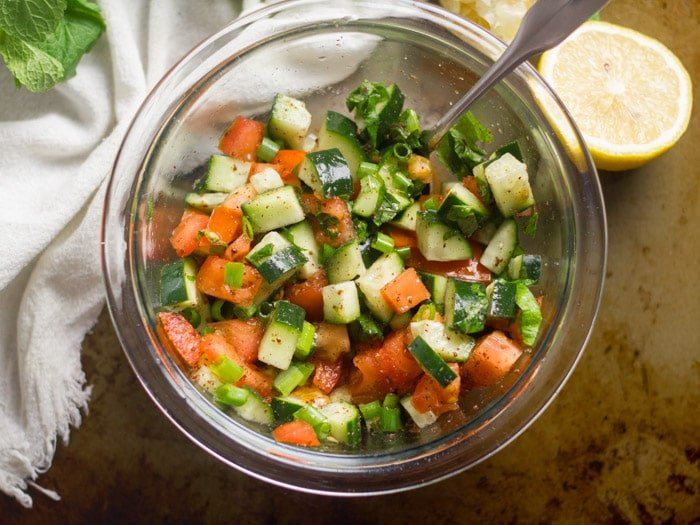Cucumber Tomato Salad in a Glass Bowl with Spoon