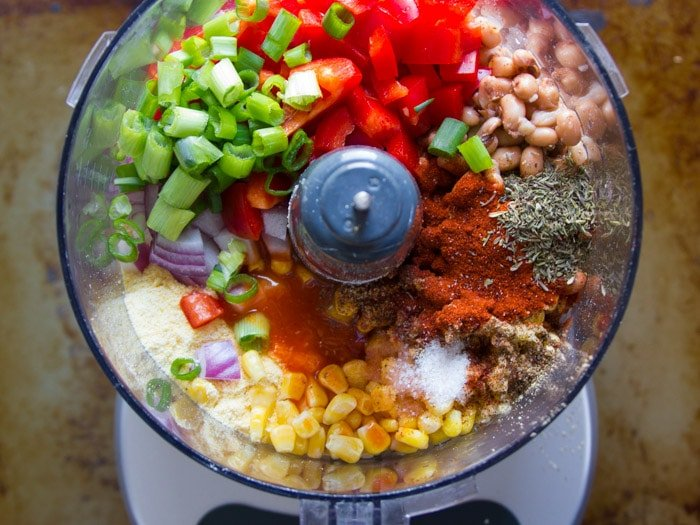 Ingredients for Making Cajun Black-Eyed Pea Burgers in a Food Processor Bowl