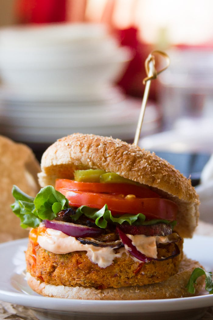 Cajun Black-Eyed Pea Burger on a Plate, Topped with Lettuce, Tomato, Pickles and Onions