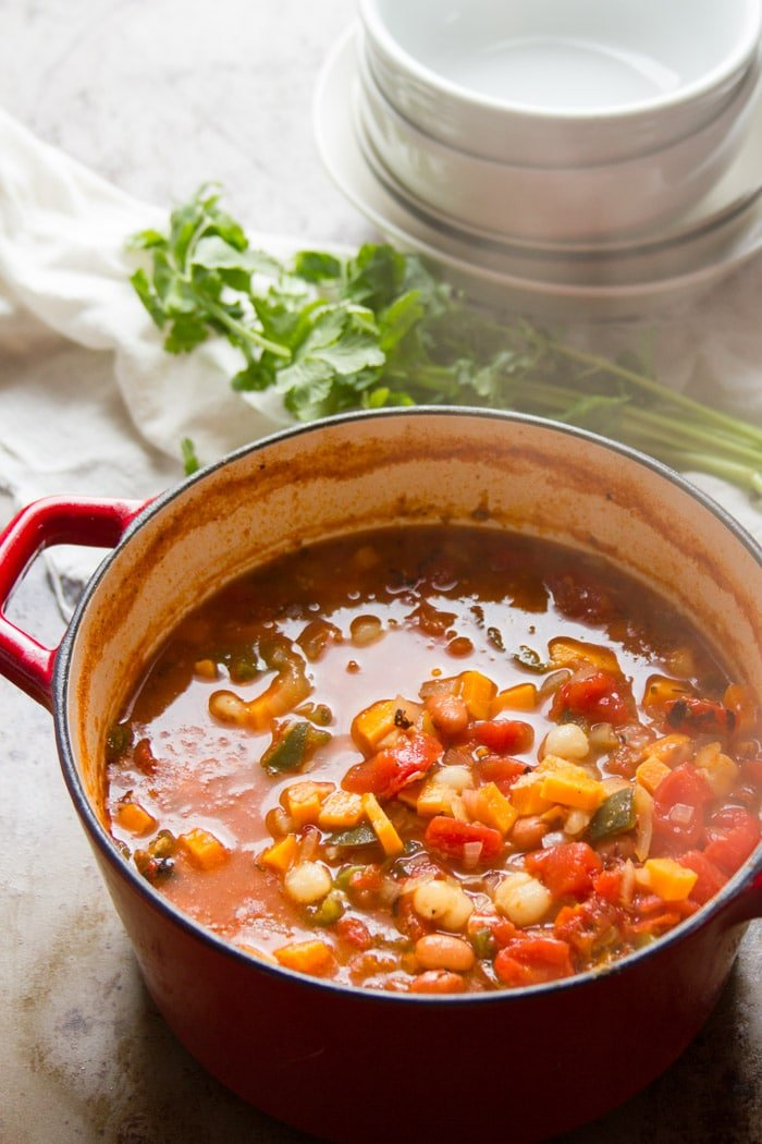 Chipotle Sweet Potato Vegan Posole in a Red Pot