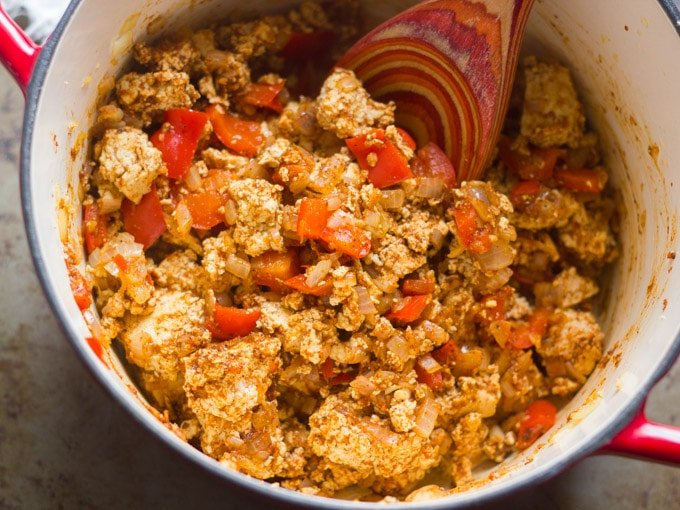 Crumbled Tofu with Peppers, Onoins and Spices Cooking in a Pot