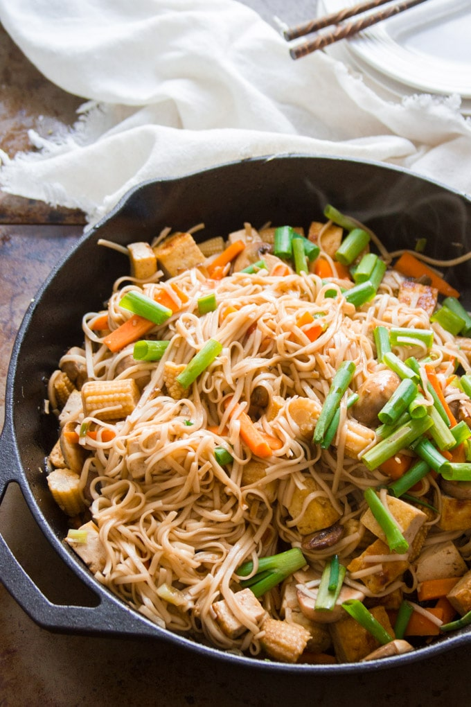Skillet filled with Vegan Vegetable Lo Mein with Napkin and Chopsticks in the Background
