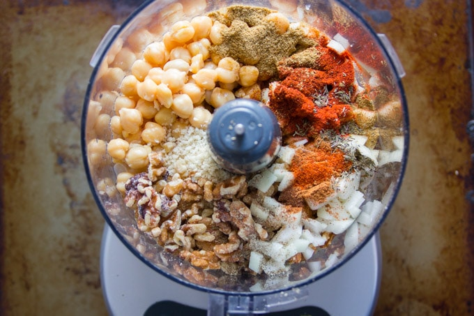 Food Processor Bowl Filled with Chickpeas, Walnuts and Spices for Making Chickpea Chorizo Burgers