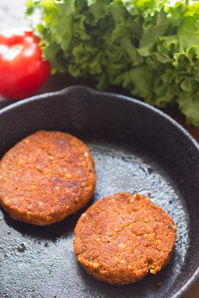 Two Chickpea Chorizo Burger Patties in a Cast Iron Skillet