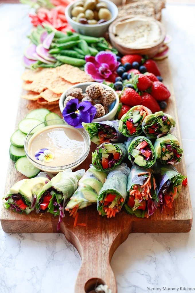 Thai Spring Rolls on a Platter with Peanut Sauce, Fruit and Flowers