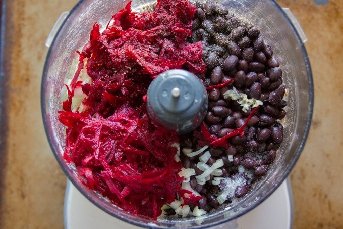 Food Processor Bowl Filled with Ingredients for Making Beet Burgers