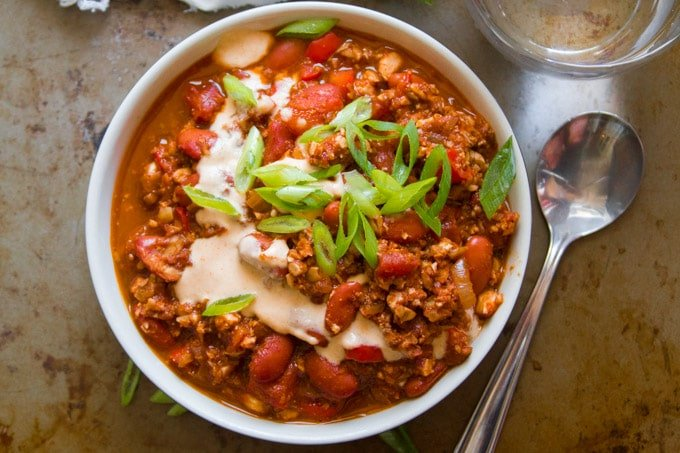 Top View of a Bowl of Meatless Chili con Carne with Spoon