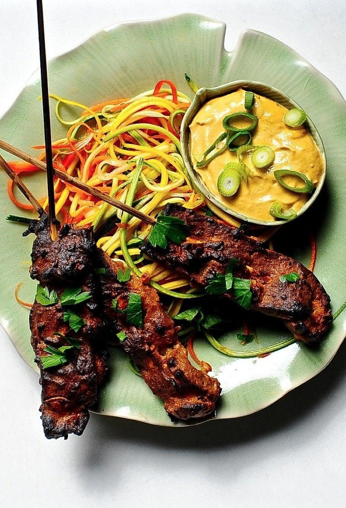 Seitan Satay on a Plate with Spicy Peanut Sauce and Ribbon-Cut Vegetables