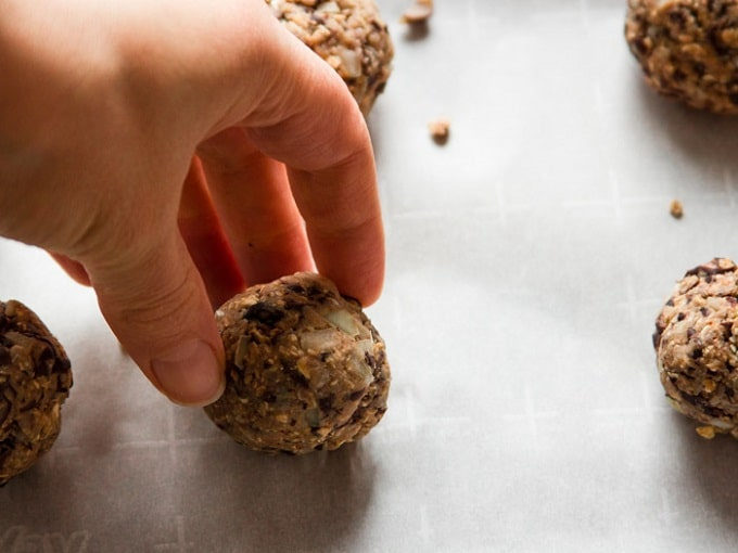 Hand Placing a Just Rolled Vegan Mexican Meatball on a Baking Sheet