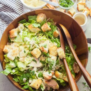 Vegan Caesar Salad in Serving Bowl with Wooden Serving Spoons