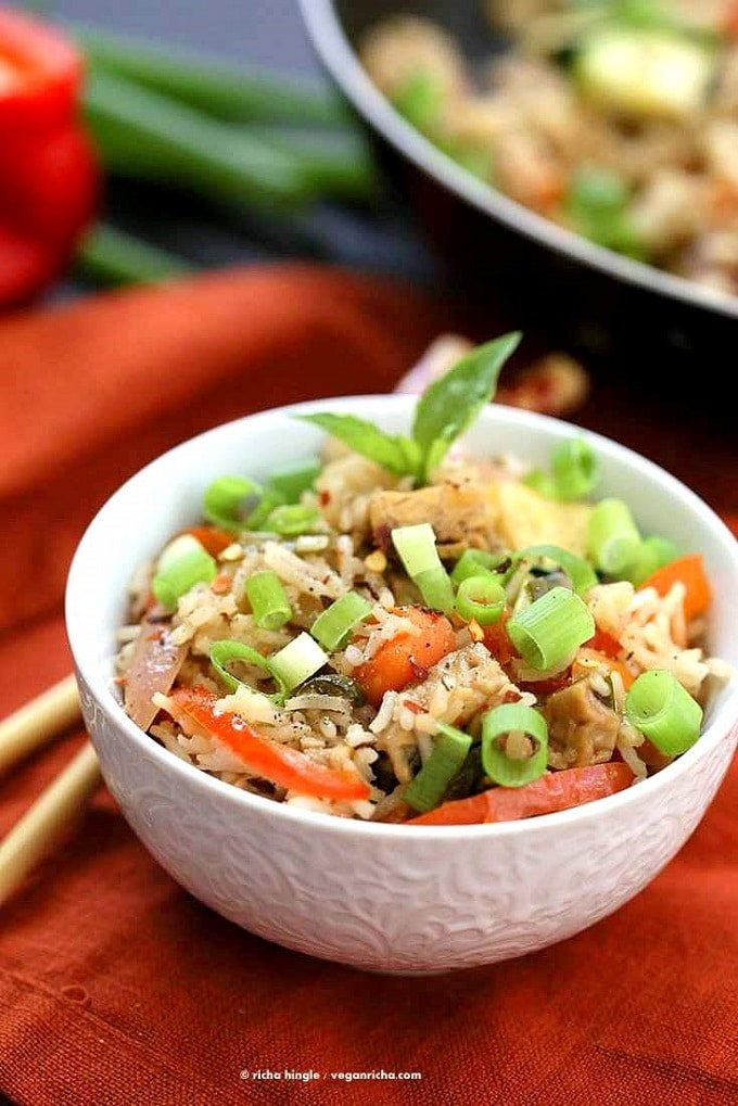 Bowl of Vegan Thai Basil Fried Rice with Chopsticks and Skillet in the Background