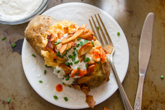 Overhead View of a Vegan Twice Baked Potato on a Plate with Fork