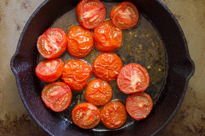 Roasted Tomatoes in a Cast Iron Skillet for Making Overhead View of A Pot of Caramelized Onion & Tomato Risotto