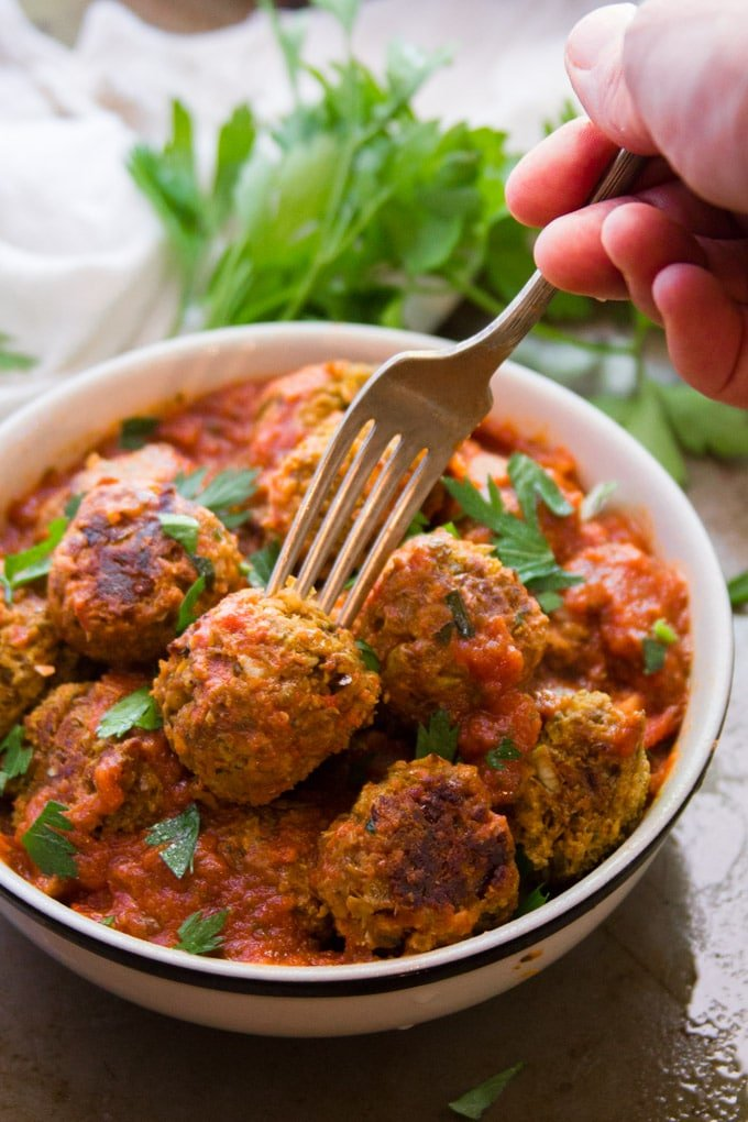 Fork Grabbing a Lentil Meatball From A Bowl