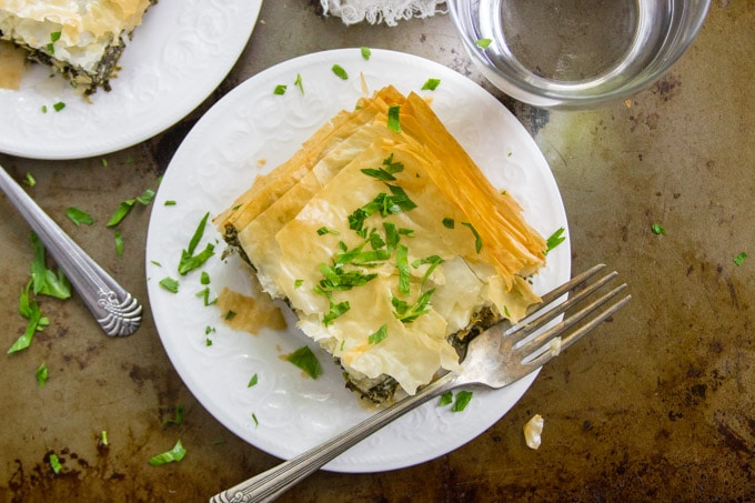 Overhead View of a Slice of Vegan Spanakopita on a Plate with Fork