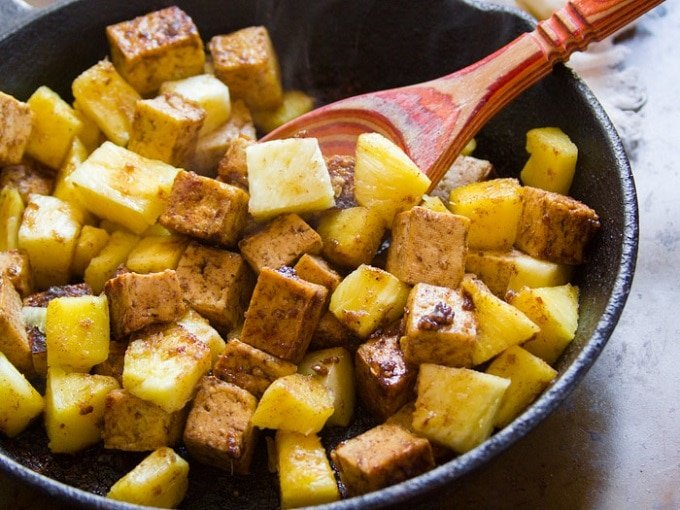 Tofu and Pineapple Sizzling in a Skillet for Jamaican Jerk Tofu Bowls