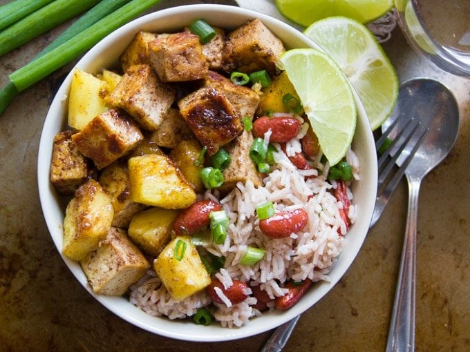Overhead View of a Jamaican Jerk Tofu Bowl with Lime Wedges
