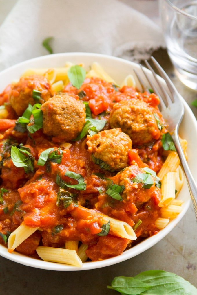 Close Up of a Bowl of Penne Arrabbiata with Lentil Meatballs