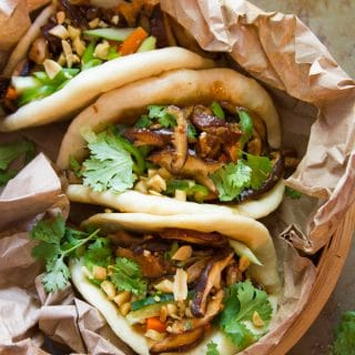 Overhead View of a Steamer Filled with Three Shiitake Mushroom Vegan Bao Buns