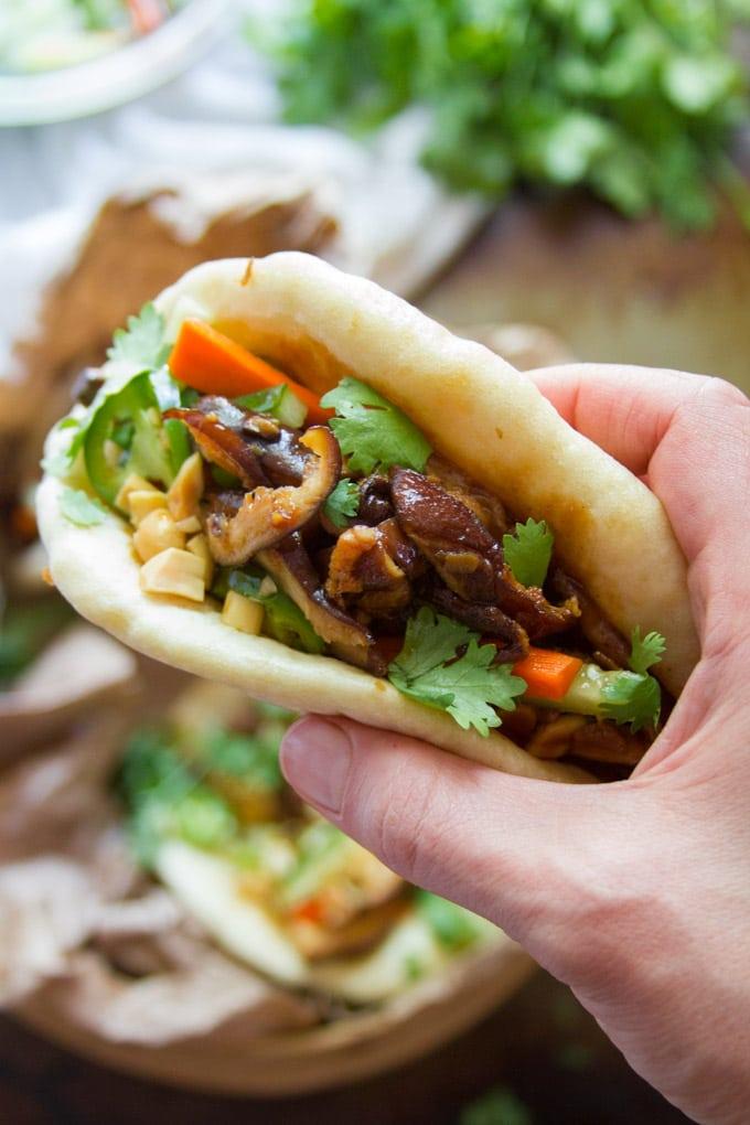 Hand Holding a Shiitake Mushroom Vegan Bao Bun