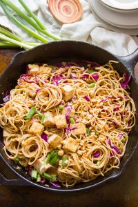 Skillet Filled with Sesame Peanut Noodles and Tofu