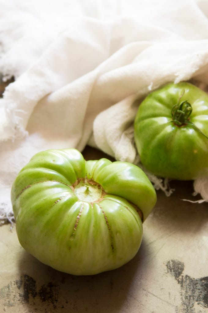 Two Green Tomatoes with Napkin in the Background